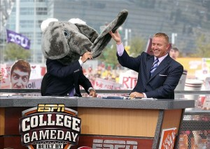 Sep 1, 2012; Arlington, TX, USA; ESPN analyst Lee Corso (left) wears the Alabama mascot head as analyst Kirk Herbstreit (right) laughs on the set of ESPN College Gameday before the game between the Alabama Crimson Tide and the Michigan Wolverines at Cowboys Stadium. Photo Credit: Kevin Jairaj-US PRESSWIRE