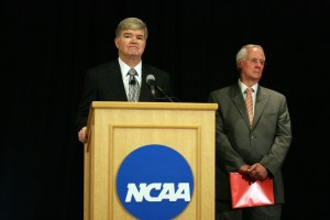 July 23, 2012; Indianapolis, IN, USA; NCAA president Mark Emmert speaks during a press conference at the NCAA Headquarters with NCAA Executive Committee chair Ed Ray standing behind him to announce corrective and punitive measures against Penn State University for the child abuse committed by former Penn State Nittany Lions assistant coach Jerry Sandusky. Mandatory Credit: Brian Spurlock-USA TODAY Sports