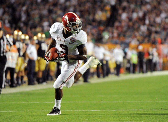 Jan 7, 2013; Miami, FL, USA; Alabama Crimson Tide wide receiver Amari Cooper (9) runs for a touchdown against the Notre Dame Fighting Irish during the second half of the 2013 BCS Championship game at Sun Life Stadium. Mandatory Credit: Steve Mitchell-USA TODAY Sports