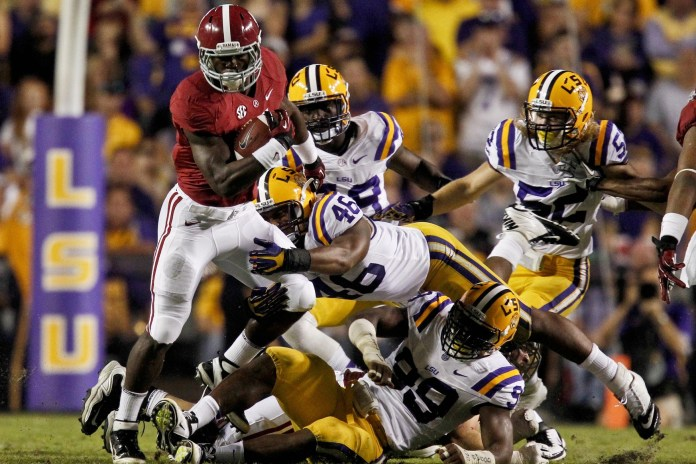 T.J. Yeldon leads a strong Alabama RB group. Here he breaks a tackle by LSU Tigers linebacker Kevin Minter (46) during the second quarter of the 2012 game at Tiger Stadium. Photo: Derick E. Hingle-USA TODAY Sports