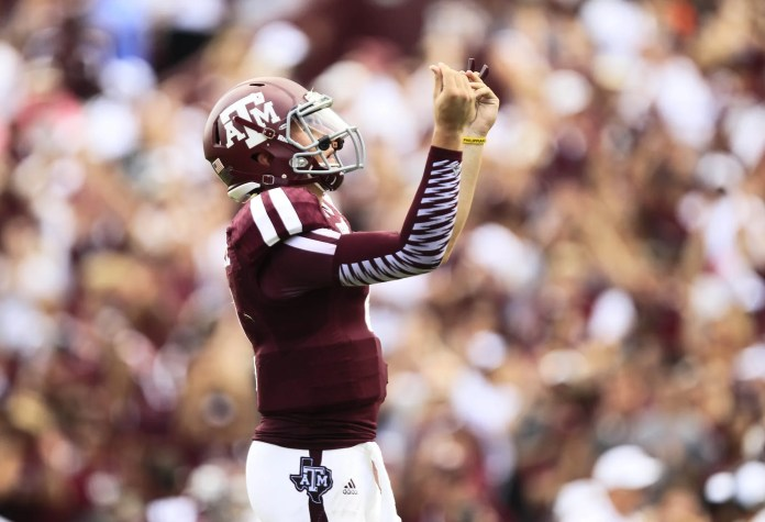 Aug 31, 2013; College Station, TX, USA; Texas A&M Aggies quarterback Johnny Manziel (2) celebrates with his signature, if not flamboyant, money rub after throwing his first touchdown of the season against the Rice Owls during the third quarter at Kyle Field. Photo Credit: Thomas Campbell-USA TODAY Sports