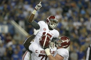 Oct 12, 2013; Lexington, KY, USA; Alabama Crimson Tide running back Kenyan Drake (17) celebrates with offensive lineman Cyrus Kouandjio (71) and offensive lineman Chad Lindsay (78) during the game against the Kentucky Wildcats at Commonwealth Stadium. Credit: Mark Zerof-USA TODAY Sports