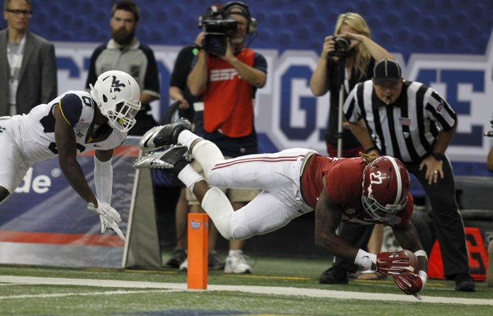 Aug 30, 2014; Atlanta, GA, USA; Alabama Crimson Tide running back Derrick Henry (27) dives in to the end zone to score a touchdown against West Virginia Mountaineers safety Dravon Henry (6) in the third quarter of the 2014 Chick-fil-A Kickoff Game at the Georgia Dome. Mandatory Credit: Brett Davis-USA TODAY Sports