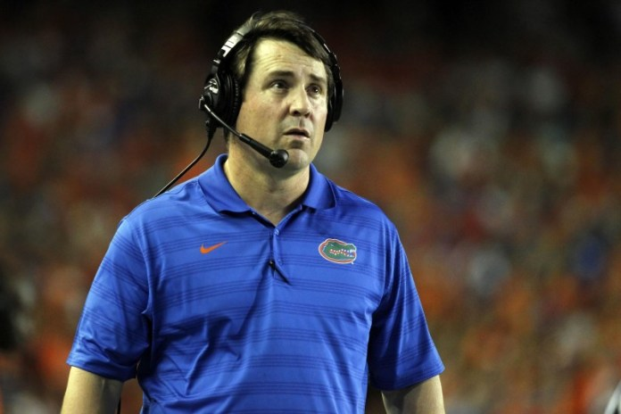 Caption: Sep 13, 2014; Gainesville, FL, USA; Florida Gators head coach Will Muschamp reacts during the first quarter against the Kentucky Wildcats at Ben Hill Griffin Stadium. Mandatory Credit: Kim Klement-USA TODAY Sports