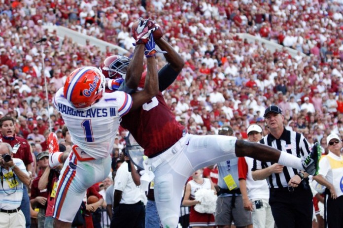 Sep 20, 2014; Tuscaloosa, AL, USA; Alabama Crimson Tide wide receiver Amari Cooper (9) catches a pass for a touchdown as Florida Gators defensive back Vernon Hargreaves (1) defends at Bryant-Denny Stadium. Mandatory Credit: Marvin Gentry-USA TODAY Sports