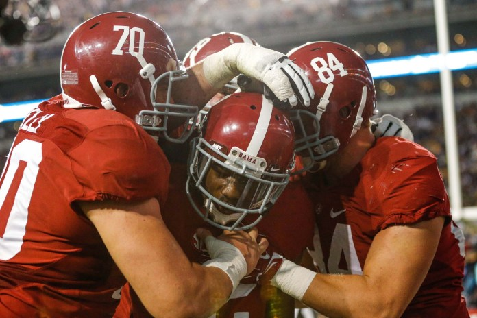 Nov 8, 2014; Baton Rouge, LA, USA; Alabama Crimson Tide wide receiver DeAndrew White (2) celebrates with teammates offensive lineman Ryan Kelly (70) and tight end Brian Vogler (84) after catching a touchdown against the LSU Tigers during the overtime of a game at Tiger Stadium. Alabama defeated LSU 20-13 in overtime. Mandatory Credit: Derick E. Hingle-USA TODAY Sports