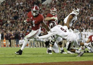 Nov 15, 2014; Tuscaloosa, AL, USA; Alabama Crimson Tide running back T.J. Yeldon (4) carries the past Mississippi State Bulldogs defensive back Justin Cox (9) for a touchdown in the fourth quarter at Bryant-Denny Stadium. Mandatory Credit: Marvin Gentry-USA TODAY Sports