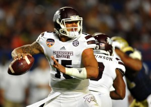 Dec 31, 2014; Miami Gardens, FL, USA; Mississippi State Bulldogs quarterback Dak Prescott (15) throws a pass against the Georgia Tech Yellow Jackets during the first quarter in the 2014 Orange Bowl at Sun Life Stadium. Mandatory Credit: Steve Mitchell-USA TODAY Sports