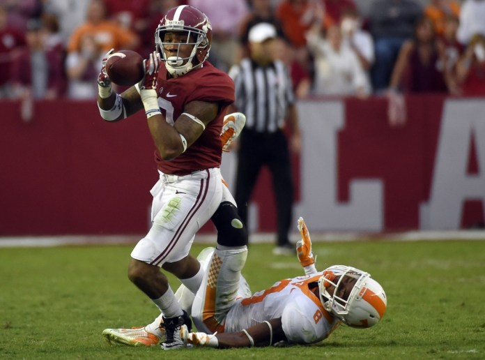 Oct 24, 2015; Tuscaloosa, AL, USA; Alabama Crimson Tide wide receiver ArDarius Stewart (13) pulls down a pass over Tennessee Volunteers defensive back Justin Martin (8) during the fourth quarter at Bryant-Denny Stadium. Mandatory Credit: John David Mercer-USA TODAY Sports