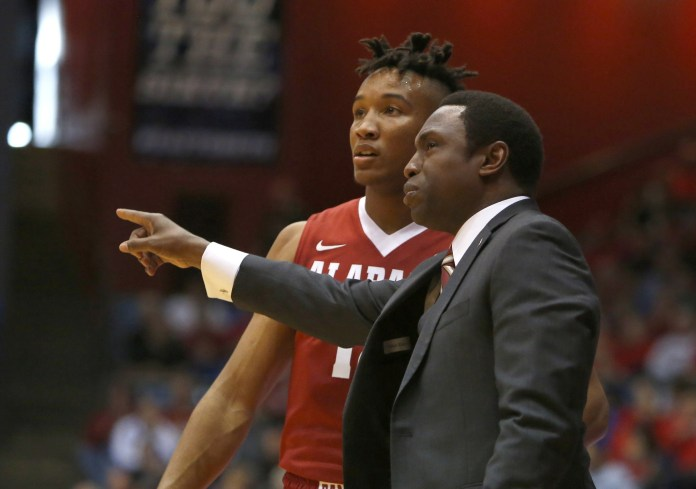 Nov 17, 2015; Dayton, OH, USA; Alabama Crimson Tide head coach Avery Johnson (right) talks with guard Dazon Ingram (left) during the first half against the Dayton Flyers at University of Dayton Arena. Mandatory Credit: David Kohl-USA TODAY Sports