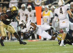 Oct 11, 2014; Nashville, TN, USA; Charleston Southern Buccaneers running back Mike Holloway (27) falls forward for a short gain during the first half against the Vanderbilt Commodores at Vanderbilt Stadium. Mandatory Credit: Christopher Hanewinckel-USA TODAY Sports