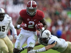 Nov 21, 2015; Tuscaloosa, AL, USA; Alabama Crimson Tide running back Derrick Henry (2) is hit by Charleston Southern Buccaneers linebacker Zack Johnson (22) as he goes for a score at Bryant-Denny Stadium. Mandatory Credit: Marvin Gentry-USA TODAY Sports