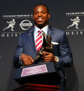 Dec 12, 2015; New York, NY, USA; Alabama running back Derrick Henry poses with the Heisman Trophy during a press conference at the New York Marriott Marquis after winning the trophy during the 81st annual Heisman Trophy presentation. Mandatory Credit: Brad Penner-USA TODAY Sports