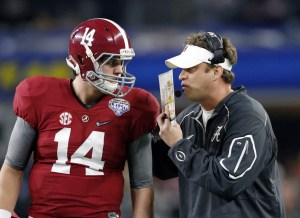 Dec 31, 2015; Arlington, TX, USA; Alabama Crimson Tide quarterback Jake Coker (14) talks with offensive coordinator Lane Kiffin in the first half against the Michigan State Spartans in the 2015 CFP semifinal at the Cotton Bowl at AT&T Stadium. Mandatory Credit: Matthew Emmons-USA TODAY Sports