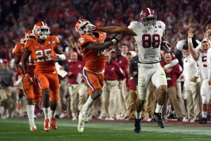 Jan 11, 2016; Glendale, AZ, USA; Alabama Crimson Tide tight end O.J. Howard (88) runs the ball against Clemson Tigers safety T.J. Green (15) during the fourth quarter in the 2016 CFP National Championship at University of Phoenix Stadium. Mandatory Credit: Joe Camporeale-USA TODAY Sports