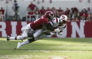 Sep 10, 2016; Tuscaloosa, AL, USA; Western Kentucky Hilltoppers wide receiver Taywan Taylor (2) is tackled by Alabama Crimson Tide defensive back Eddie Jackson (4) at Bryant-Denny Stadium. The Tide defeated the Hilltoppers 38-10. Mandatory Credit: Marvin Gentry-USA TODAY Sports