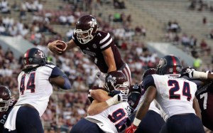 Oct 29, 2016; Starkville, MS, USA; Mississippi State Bulldogs quarterback Nick Fitzgerald (7) dives over the goalie for the score against Samford Bulldogs at Davis Wade Stadium. The Bulldogs defeated the Bulldogs 56-41. Mandatory Credit: Marvin Gentry-USA TODAY Sports