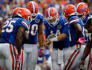 Oct 15, 2016; Gainesville, FL, USA; Florida Gators quarterback Luke Del Rio (14) huddles up with teammates to call a play against the Missouri Tigers during the second half at Ben Hill Griffin Stadium. Florida Gators defeated the Missouri Tigers 40-14. Mandatory Credit: Kim Klement-USA TODAY Sports