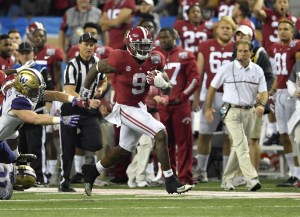 Dec 31, 2016; Atlanta, GA, USA; Alabama Crimson Tide running back Bo Scarbrough (9) runs the ball for a touchdown against the Washington Huskies during the fourth quarter in the 2016 CFP semifinal at the Peach Bowl at the Georgia Dome. Mandatory Credit: Dale Zanine-USA TODAY Sports