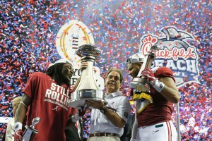 Dec 31, 2016; Atlanta, GA, USA; Alabama Crimson Tide running back Bo Scarbrough (9), head coach Nick Saban, and linebacker Ryan Anderson (22) hold up their trophies after the game against the Washington Huskies in the 2016 CFP Semifinal at the Georgia Dome. Alabama defeated Washington 24-7. Mandatory Credit: Jason Getz-USA TODAY Sports