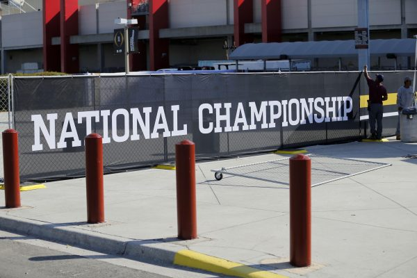 Jan 5, 2017; Tampa, FL, USA; Workers put up signs at Raymond James Stadium where the College Football Championship will be played between the Clemson Tigers and the Alabama Crimson Tide on Monday night. Mandatory Credit: Kim Klement-USA TODAY Sports