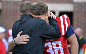 Nov 26, 2016; Oxford, MS, USA; Mississippi Rebels head coach Hugh Freeze embraces defensive end John Youngblood (38) before the game against the Mississippi State Bulldogs at Vaught-Hemingway Stadium. Mandatory Credit: Matt Bush-USA TODAY Sports