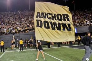 Sep 16, 2017; Nashville, TN, USA; A Vanderbilt Commodores Cheerleader waves a flag in celebration following her teams victory over the Kansas State Wildcats 14-7 at Vanderbilt Stadium. Mandatory Credit: Jim Brown-USA TODAY Sports