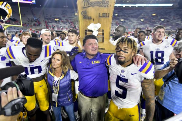 Oct 21, 2017; Oxford, MS, USA; LSU Tigers head coach Ed Orgeron celebrates with his players after a game against the Mississippi Rebels at Vaught-Hemingway Stadium. Mandatory Credit: Matt Bush-USA TODAY Sports