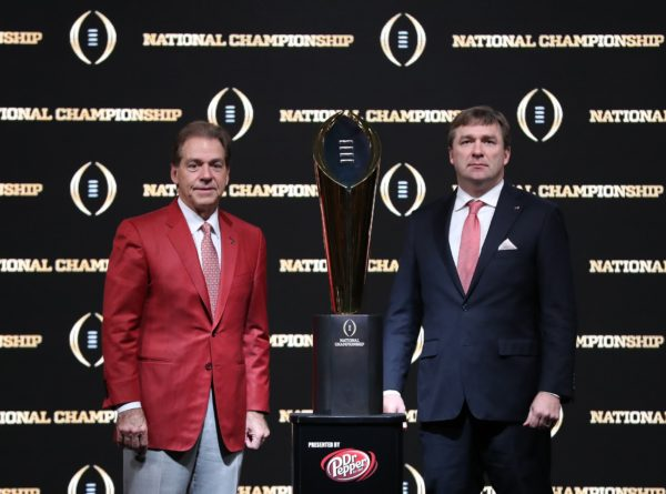 Jan 7, 2018; Atlanta, GA, USA; Alabama Crimson Tide head coach Nick Saban (left) poses for a photo with Georgia Bulldogs head coach Kirby Smart and College Football Playoff National Championship Trophy at Sheraton Atlanta. Mandatory Credit: Matthew Emmons-USA TODAY Sports