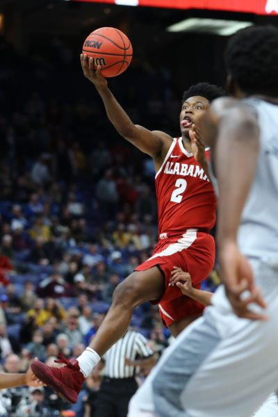 Mar 8, 2018; St. Louis, MO, USA; Alabama Crimson Tide guard Collin Sexton (2) gets off the game-winning shot during the second half of the second round of the SEC Conference Tournament against the Texas A&M Aggies at Scottrade Center. Alabama won 71-70. Mandatory Credit: Billy Hurst-USA TODAY Sports