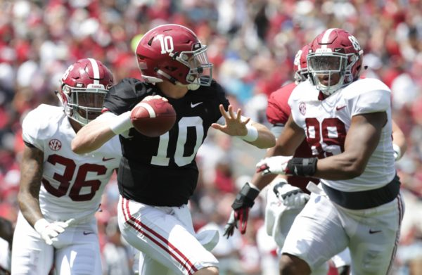 Apr 21, 2018; Tuscaloosa, AL, USA; Alabama Crimson Tide quarterback Mac Jones (10) looks to pass as Alabama Crimson Tide defensive lineman LaBryan Ray (89) put the pressure on him during the A-day game at Bryant Denny Stadium. Mandatory Credit: Marvin Gentry-USA TODAY Sports