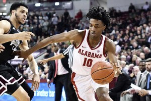 Feb 6, 2018; Starkville, MS, USA; Alabama Crimson Tide guard Herbert Jones (10) handles the ball as he is defended by Mississippi State Bulldogs guard Quinndary Weatherspoon (11) during the second half at Humphrey Coliseum. Mandatory Credit: Matt Bush-USA TODAY Sports