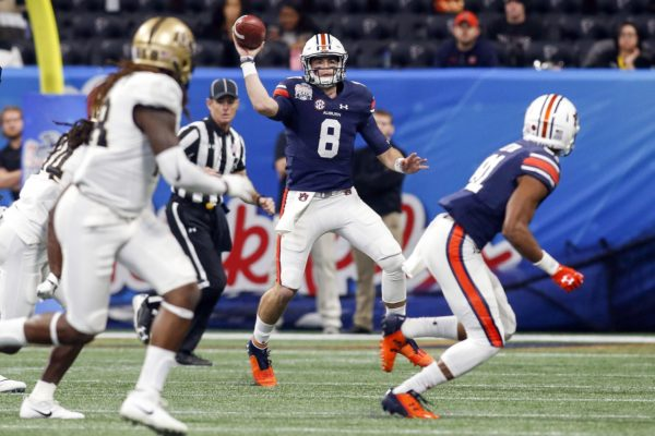Jan 1, 2018; Atlanta, GA, USA; Auburn Tigers quarterback Jarrett Stidham (8) throws a pass against the Central Florida Knights in the first quarter in the 2018 Peach Bowl at Mercedes-Benz Stadium. Mandatory Credit: Brett Davis-USA TODAY Sports