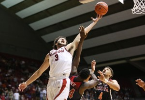 Dec 9, 2018; Tuscaloosa, AL, USA; Alabama Crimson Tide forward Alex Reese (3) grabs a rebound against Arizona Wildcats guard Emmanuel Akot (24) during the second half at Coleman Coliseum. Mandatory Credit: Marvin Gentry-USA TODAY Sports