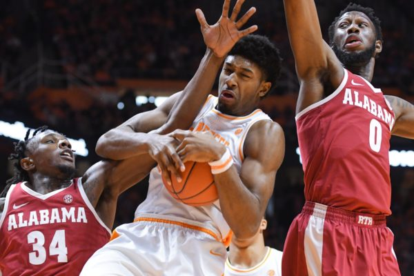 Jan 19, 2019; Knoxville, TN, USA; Alabama Crimson Tide guard Tevin Mack (34) and forward Donta Hall (0) battle Tennessee Volunteers forward Kyle Alexander (11) for a rebound during the first half at Thompson-Boling Arena. Mandatory Credit: Randy Sartin-USA TODAY Sports
