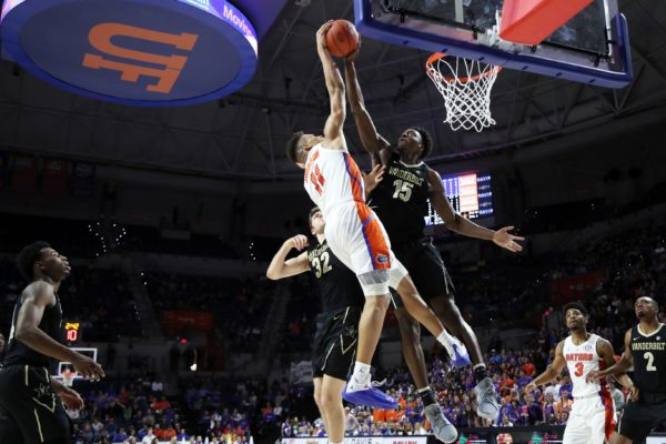 Feb 13, 2019; Gainesville, FL, USA; Vanderbilt Commodores forward Clevon Brown (15) fouls Florida Gators forward Keyontae Johnson (11) shot during the second half at Exactech Arena. Mandatory Credit: Kim Klement-USA TODAY Sports