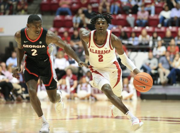 Feb 6, 2019; Tuscaloosa, AL, USA; Alabama Crimson Tide guard Kira Lewis Jr. (2) controls the ball against Georgia Bulldogs guard Jordan Harris (2) during the second half at Coleman Coliseum. Mandatory Credit: Marvin Gentry-USA TODAY Sports