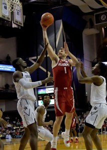 Feb 9, 2019; Nashville, TN, USA; Alabama Crimson Tide guard Riley Norris (1) shoots against Vanderbilt Commodores forward Simisola Shittu (11) during the first half at Memorial Gymnasium. Mandatory Credit: Jim Brown-USA TODAY Sports