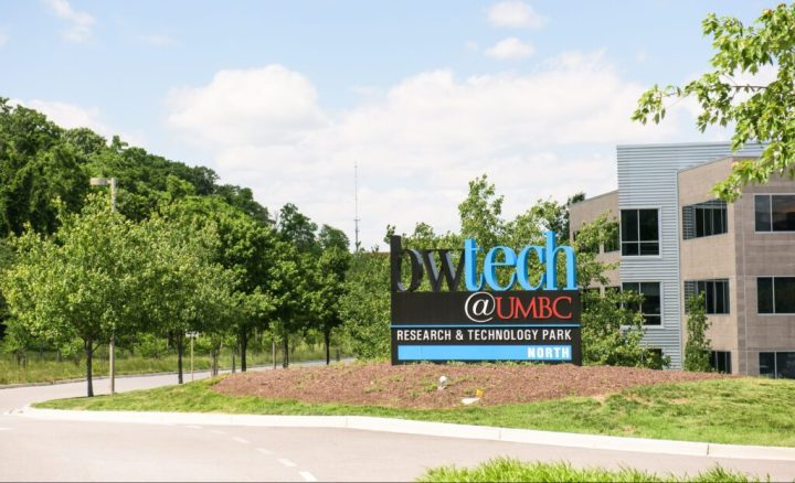 "Sign reading ""bwtech@UMBC Research & Technology Park -- NORTH"" next to trees and office buildings."