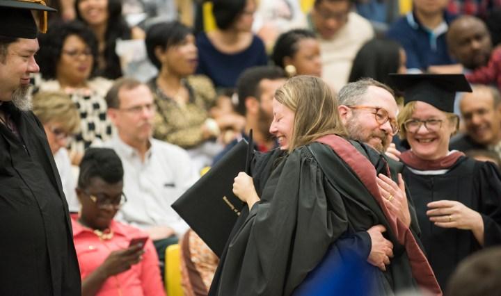 Prof. Tim Nohe congrats Melissa Cormier upon receiving her MFA degree.