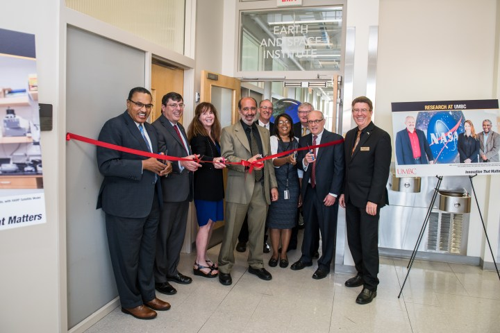UMBC and NASA Goddard representatives cut a ribbon to dedicate the ESI.