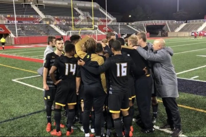 UMBC men's soccer huddles up during semifinal game against Stony Brook.