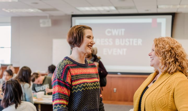 Victoria Herr, right, talking with CWIT's Cindy Greenwood during a stress buster event during finals.