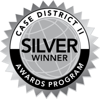 """Silver graphic of a globe with accents and text """"CASE DISTRICT II AWARDS PROGRAM SILVER WINNER"""""""