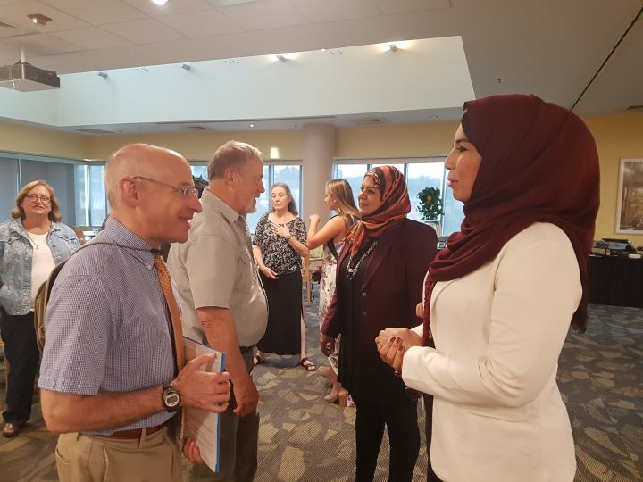 Scot Casper, dean of the College of Arts, Humanities, and Social Sciences, speaking with a faculty from Egypt.