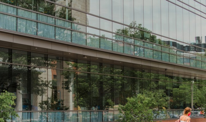 Reflective windows of a science building, as seen from the outside.
