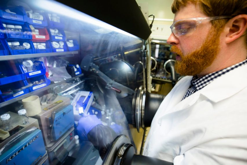 Nathan Taylor, a post-doctoral fellow in mechanical engineering, inspects a piece of lithium metal in the Phoenix Memorial Laboratory building. Image credit: Evan Dougherty, Michigan Engineering