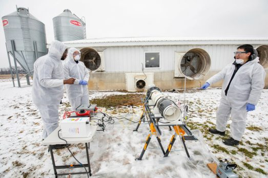 Civil and Environmental Engineering Professor Herek Clack (left) and members of his team set up a lab-scale non-thermal plasma device that has previously been proven to achieve greater than 99% inactivation of an airborne viral surrogate, MS2 phage, a virus that infects E.coli bacteria at the Barton Farms family pig farm in Homer, MI. Image credit: Robert Coelius/Michigan Engineering