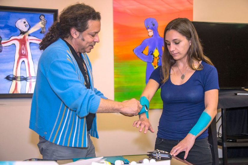 Using art to heal: Breana Wiles paints her arms in art therapy workshop with Art Rx
