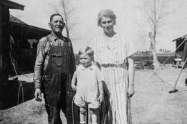 Education driven Tom Capehart in a photo with his parents at their family farm. Tom's dad is on the left and mom on right.